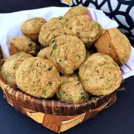 A basket full of zucchini Muffins