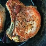 Easy Baked Pork Chops are the simplest way to guarantee juicy chops every time. Find out the 3 steps that will fix dried out pork forever. A healthy dinner meal made from scratch in no time at all.