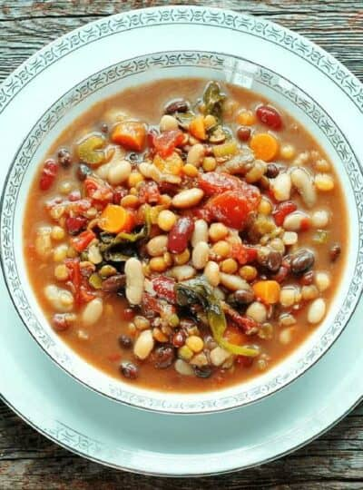 A bowl of food on a plate, with Bean and Minestrone