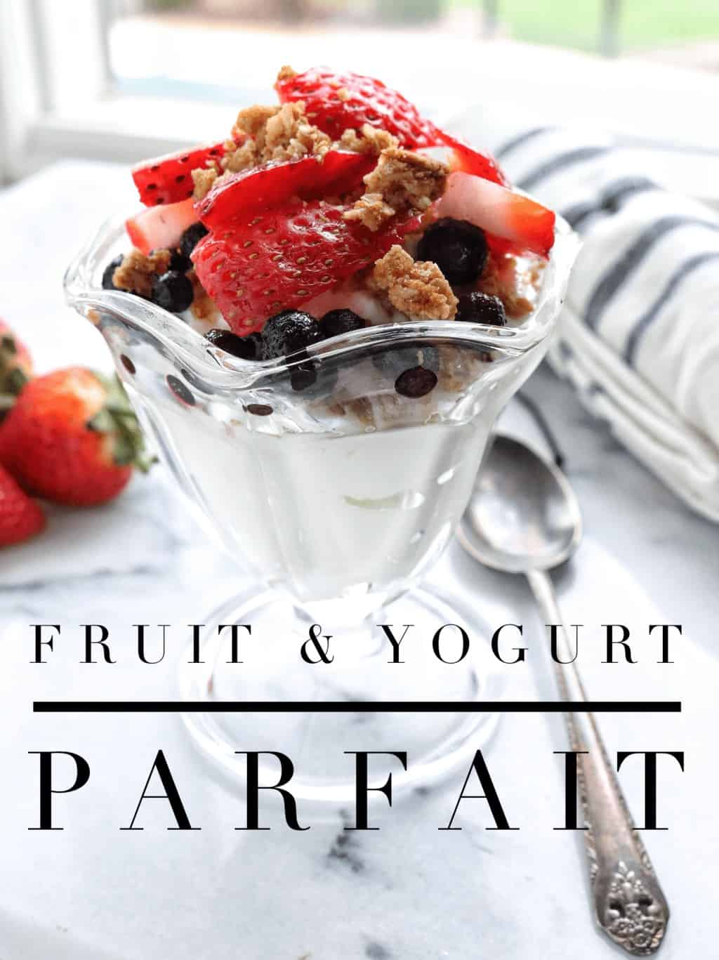 a fruit parfait in a clear bowl.