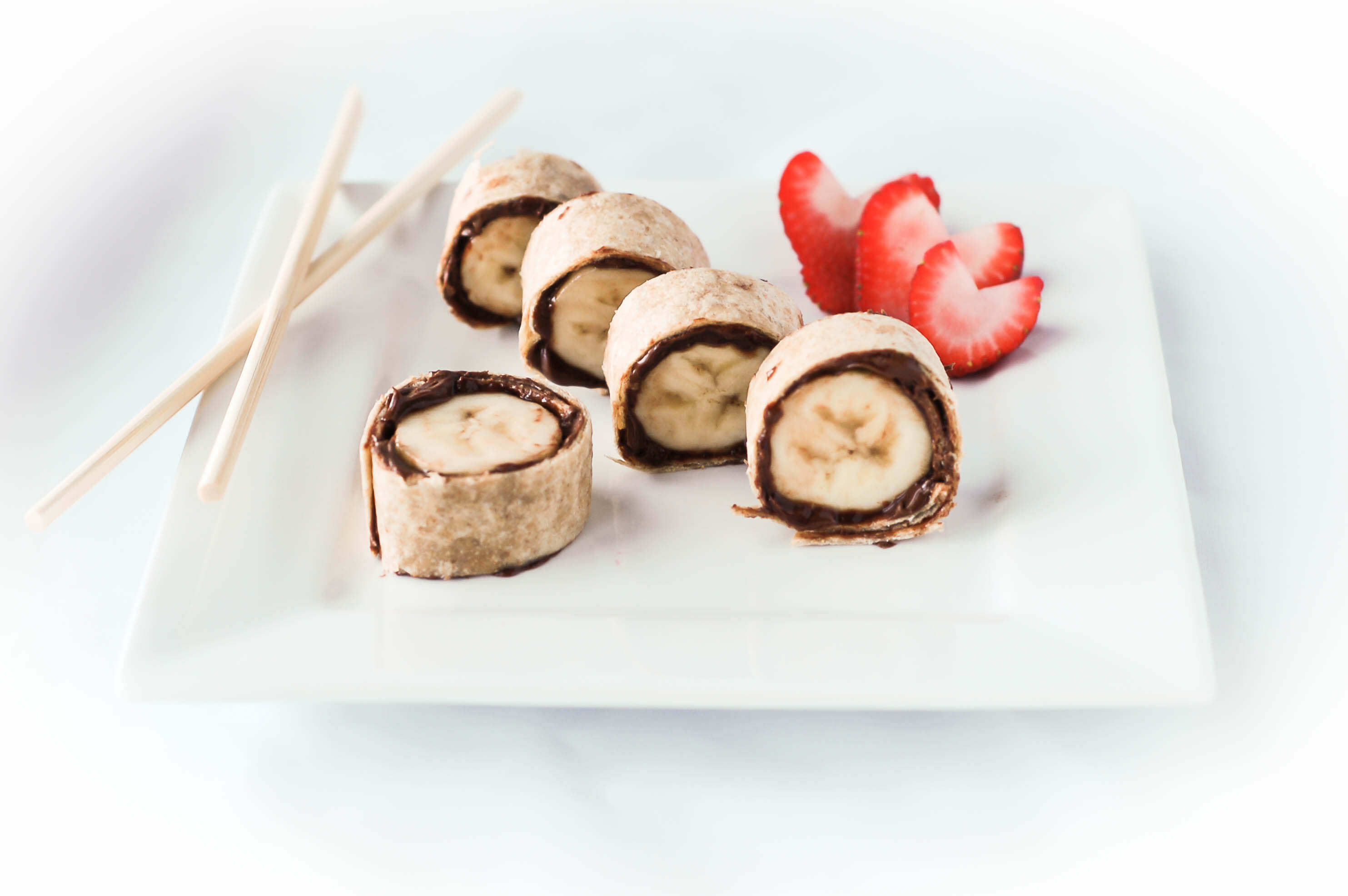 Banana sushi made with nutella and tortillas are an easy snack recipe perfect for lunch boxes via createkidsclub.com
