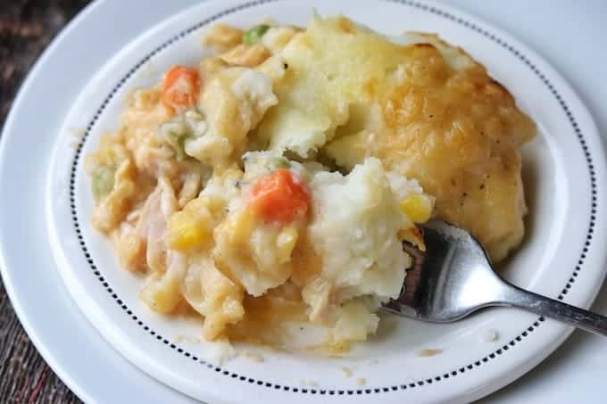 mashed potatoes, carrots, chicken and corn on a plate