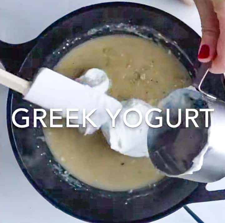 greek yogurt being added to the sauté pan with a spatula.