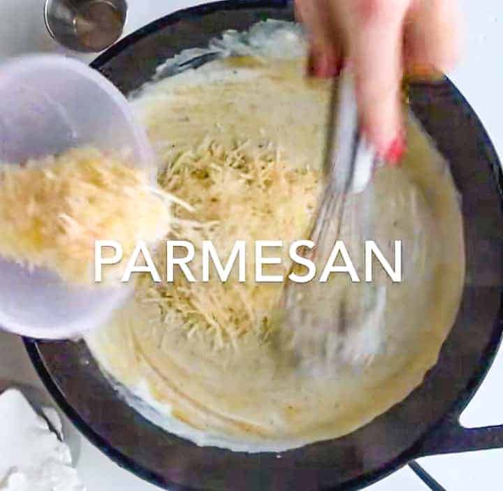 parmesan cheese being added to the sauté pan with the Greek yogurt sauce.