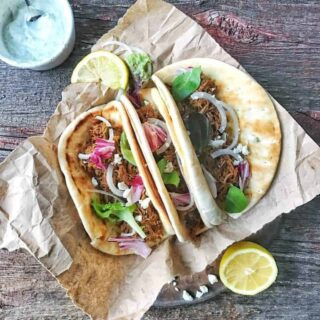 Crock Pot Pork Tacos Gyro Style are a simple dinner recipe. Use the meat for many different recipes including pulled pork on a bun and enchiladas. Get all the recipes