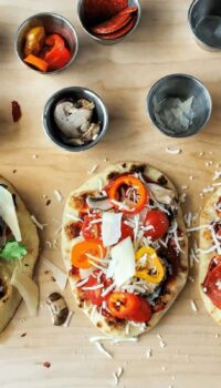 three naan pizzas with toppings