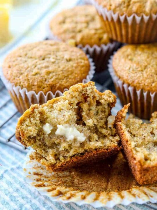 Bran muffins on a try with one in half with butter