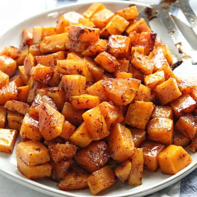 Caramelized butternut squash cubes on a plate.