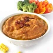 Sweet Corn & Sun-Dried Tomato Hummus recipe is oil free, tahini free, has just 5 ingredients. It is the perfect spring or summer appetizer that utilizes fresh corn on the cob blended with sun-dried tomatoes for a delicious and unique hummus sure to please your guests.