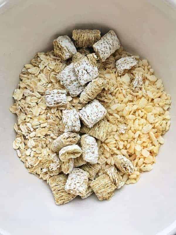 a bowl shown up close with Rice Krispies, halts, and shredded wheat cereals.