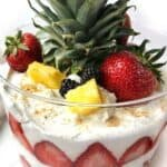 Light Summer Desserts: Strawberry Lemon Curd Trifle is the perfect light and healthy summer dessert to bring to your next party. This beauty is simple to prepare with only 6 ingredients. Greek yogurt is flavored with lemon curd making a delicious sauce that is layered with Nilla Wafers, cool whip, and fruit.