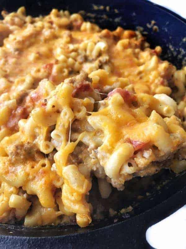 Butternut Squash Mac and Cheese Recipe shown close up in a cast iron pan.