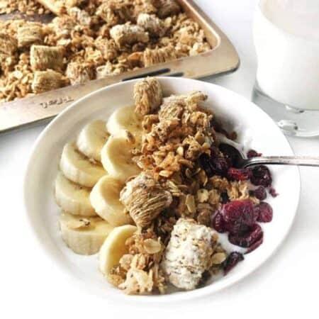 a bowl with bananas and granola