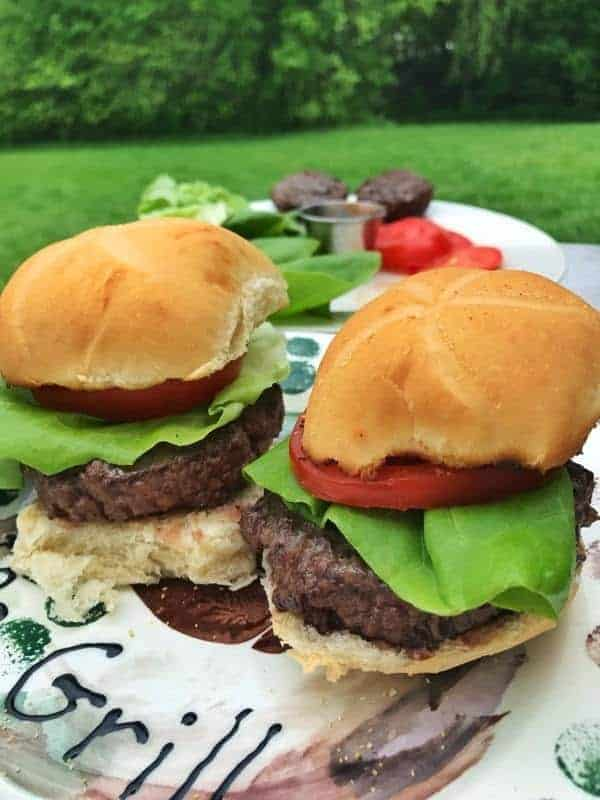 Homemade Burgers: The Cheese Curd Juicy Lucy will be the best thing to hit your grill or BBQ this summer. Learn how to make juicy burgers on the grill easily. These simple homemade hamburgers are so delicious, you won't be buying premade burgers again. Perfect for parties, grill outs, and BBQ parties.