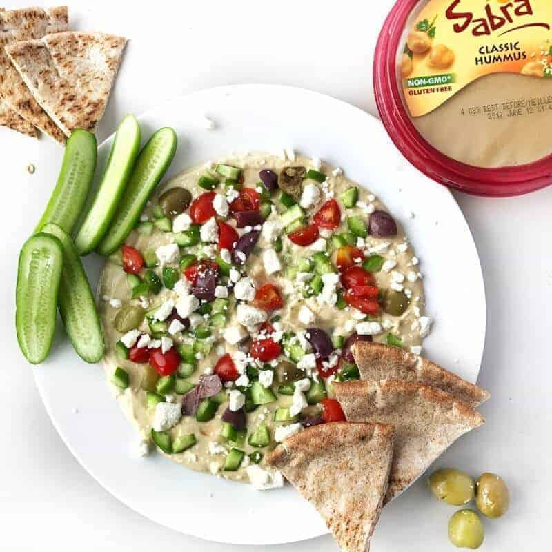 a plate of hummus with pita bread
