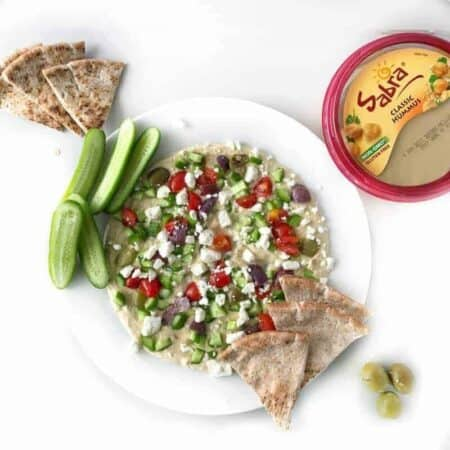 a plate of hummus with vegetables