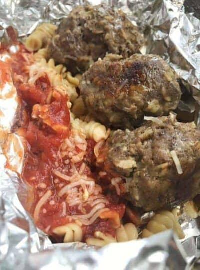 A close up of food, with Meatballs