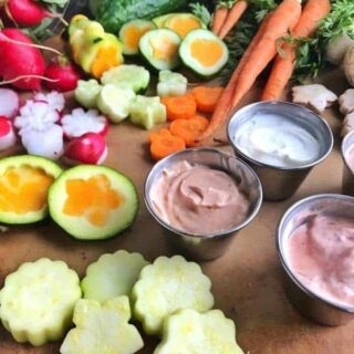 A bunch of different types of vegetables and dip