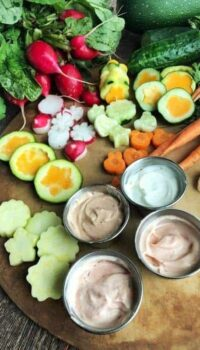 A bunch of different types of vegetable and dip