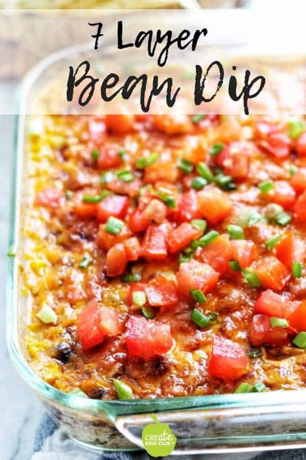 Seven Layer Bean Dip is a healthy appetizer recipe great for tailgating or entertaining.  It's a low calorie and low-fat recipe that takes under 30 minutes to make. #layeredbeandip #healthyappetizerrecipe