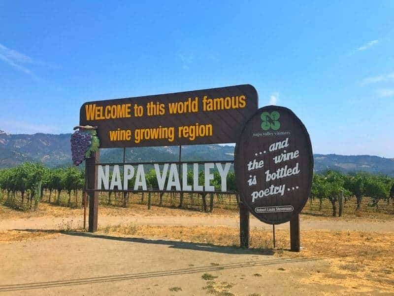 A sign on a dirt field of napa valley