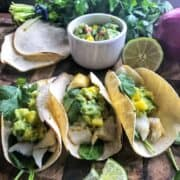 Baked Cod Fish Taco Recipe with holy moly guacamole, or a creamy guacamole perfect for fish tacos. This 20 minute family friendly dinner packs high flavor and vital nutrients your family needs.