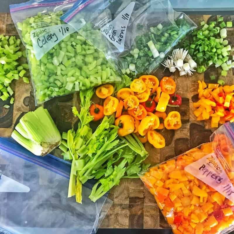 A variety of fresh vegetables on display on a cutting board