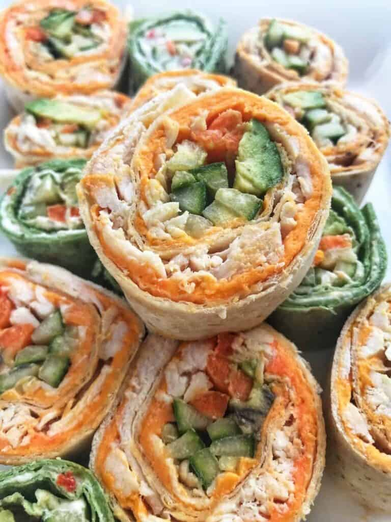 close up of pinwheels with cheese and chicken and cucumbers.