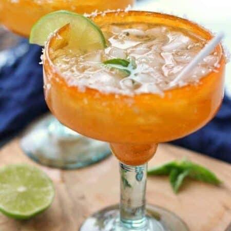 a margarita shown in an orange margarita glass.