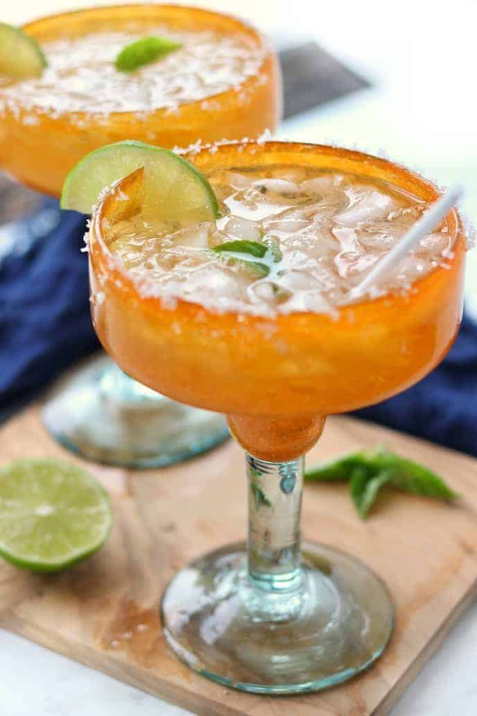 a margarita shown in an orange margarita glass.