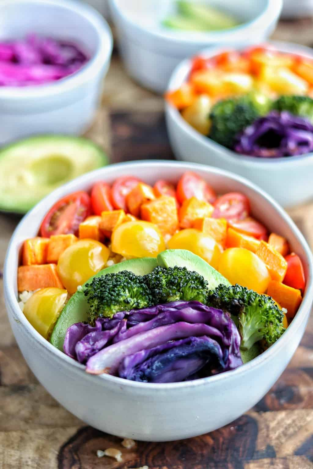 a buddha bowl with rainbow vegetables