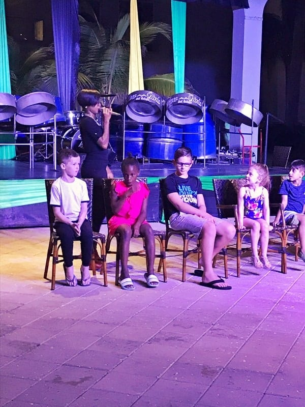 5 kids sitting in chairs participating in nightly entertainment at the Hilton Rose Hall in Jamaica.