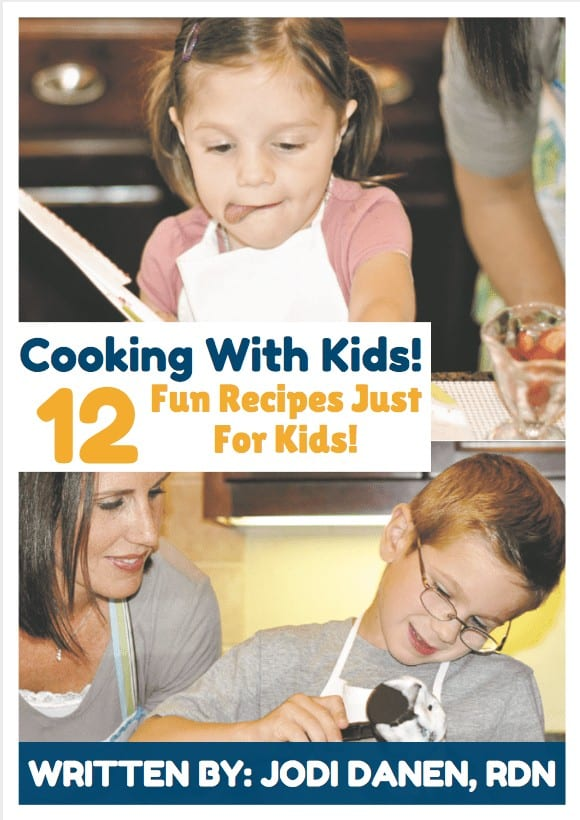 a mom and two kids cooking
