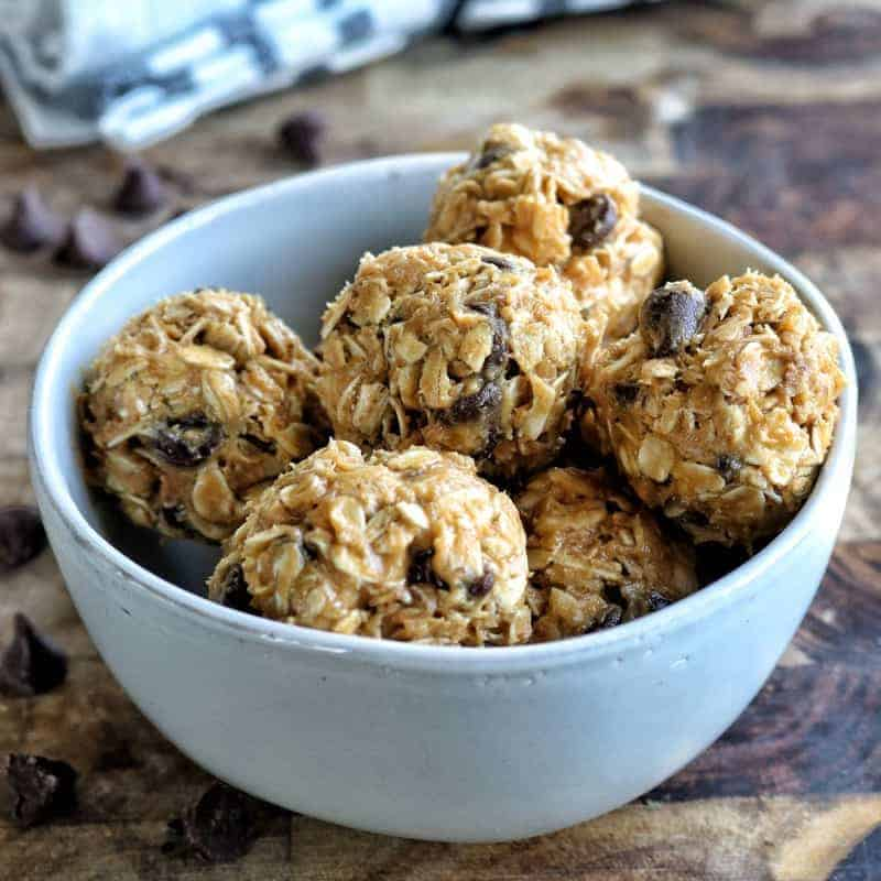 Easy snacks for kids showing peanut butter balls made with oatmeal and chocolate chips in a white bowl.