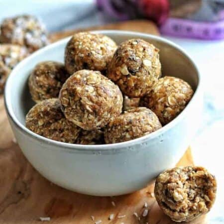 prune and peanut butter energy balls in a white bowl