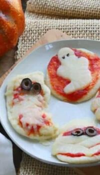 a plate with halloween pizzas