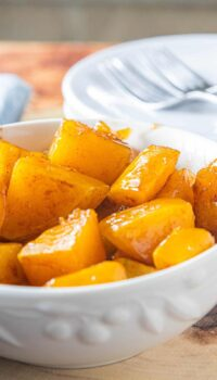 A bowl of baked squash on a table
