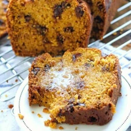chocolate chip pumpkin bread on a plate with butter.