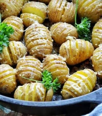 Hasselback potatoes in a skillet
