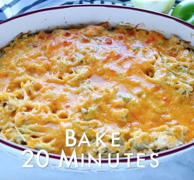 Chicken Spaghetti Recipe Chicken and pasta recipes showing baked with melted cheese on top of spaghetti noodles in a white baking pan on a white surface with the words bake 20 minutes.