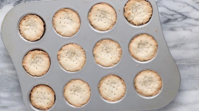 Mini tart crust shown baked in mini muffin pan.