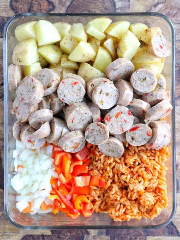 a container with chicken sausage and vegetables