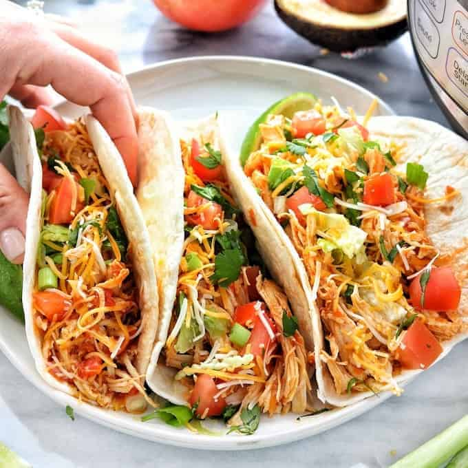 Instant pot or crockpot chicken tacos are shredded chicken tacos with just 4 ingredients.