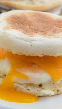 Easy Camping Meals For Kids showing an egg McMuffin with the yolk pouring down the side.