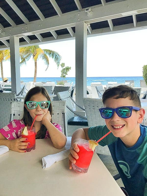 kids drinking smoothies while at the hilton rose hall jamaica