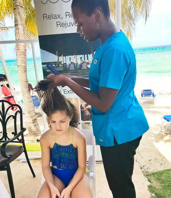 Girl getting braids at hilton rose hall jamaica