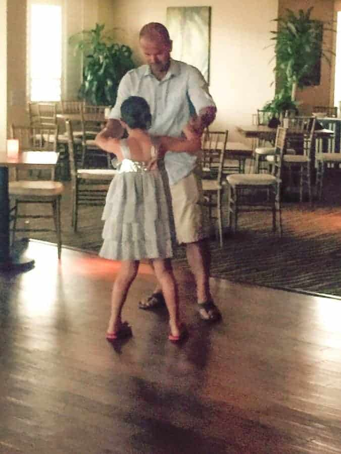 father and daughter dancing at traditions on Sanibel Island