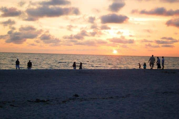 Sunset on captiva island with people in the distance.