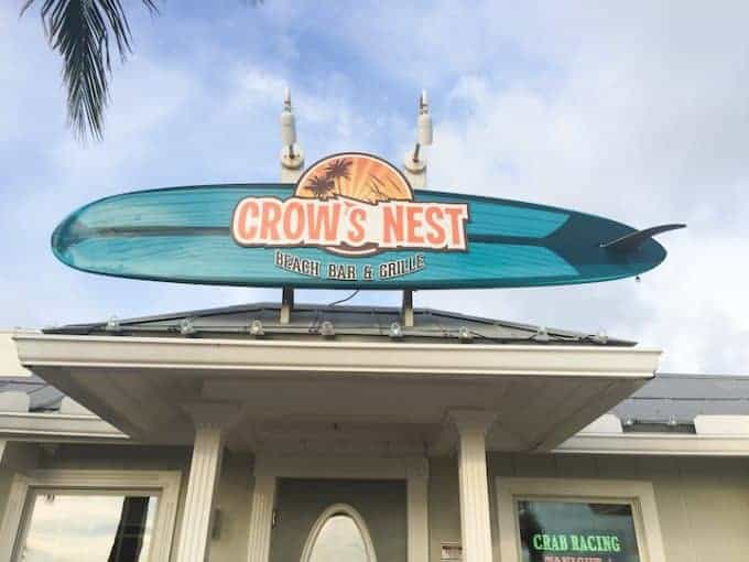 A picture of the sign outside Crows Nest Beach Bar and Grill which says the same.