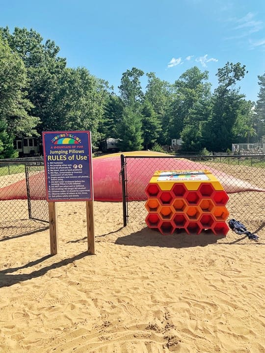 best camping in wi showcasing the jumping pillow at evergreen campground and resort and the rules of use.